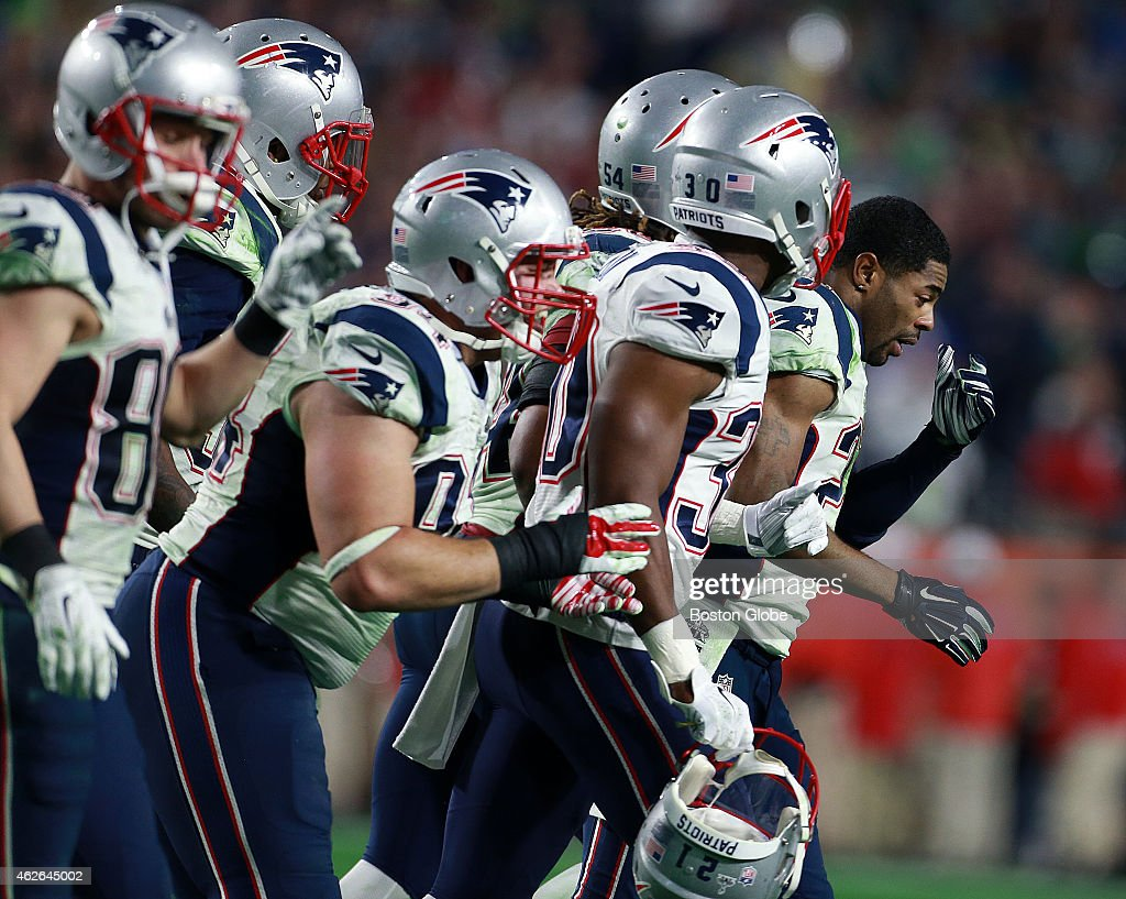 Patriots cornerback Malcolm Butler looks stunned as he leads the defense off the field following his game saving interception The New England...