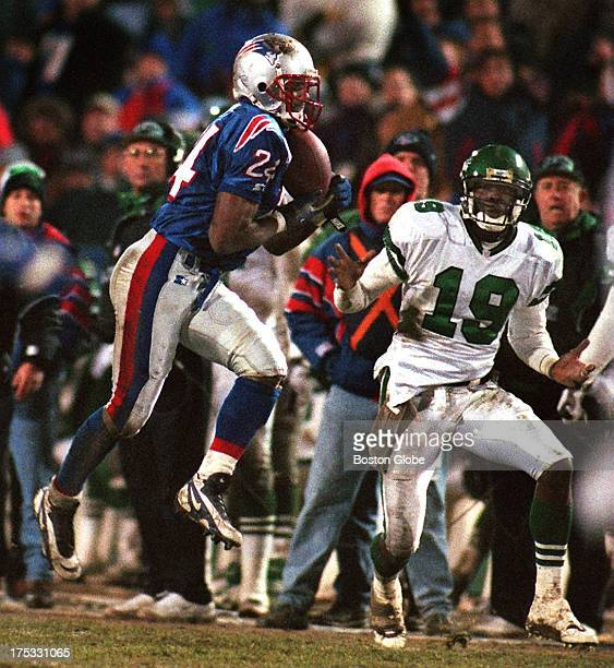 Patriots cornerback Ty Law steps in front of the Jets Keyshawn Johnson and intercepts this Glenn Foley pass that he returned for a touchdown the play...