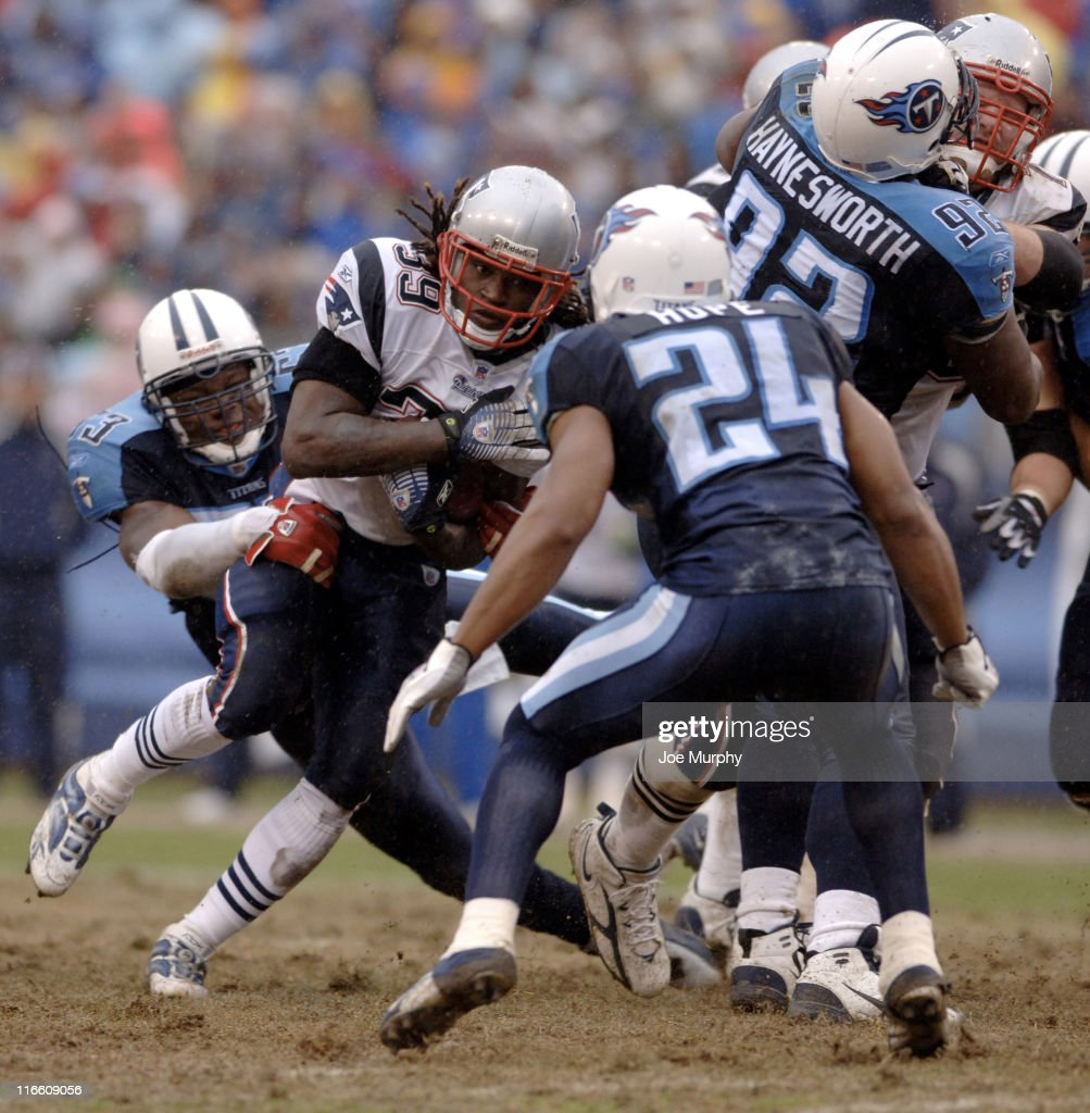 Patriots Laurence Maroney #39 is tackled by Titans Keith Bulluck #53 during 1st half action between the New England Patriots and the Tennessee Titans at LP Field in Nashville, Tennessee on December 31, 2006.