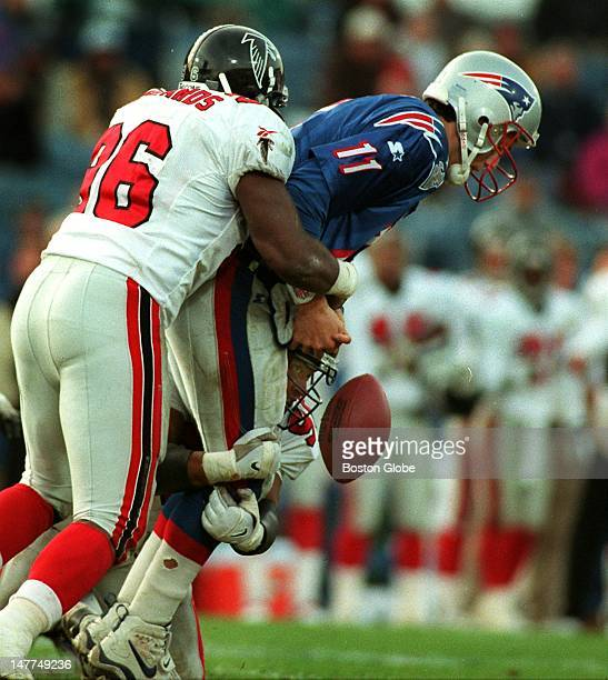 Patriots quarterback Drew Bledsoe fumbles the ball as he is hit by the Atlanta Falcons during the 4110 loss to the visitors at Foxboro Stadium...