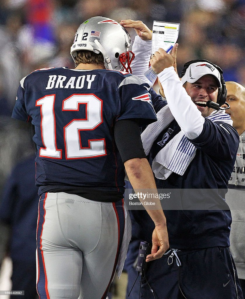 Patriots quarterback Tom Brady gets a pat on the head form a beaming offensive coordinator Josh McDaniels, right, after he threw a touchdown pass to Shane Vereeen, not pictured, as the New England Patriots hosted the Houston Texans in an NFL AFC Divisional Playoff Game at Gillette Stadium, Jan. 13, 2013.