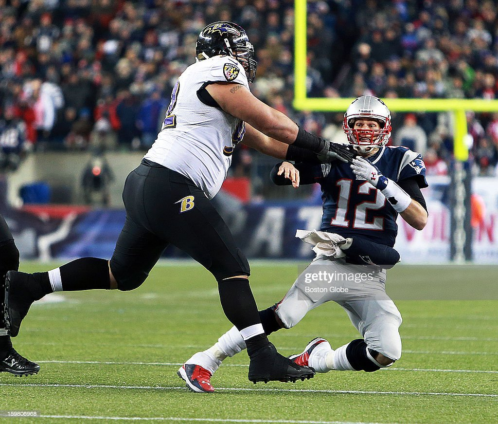 Patriots quarterback Tom Brady is headed down as he couldn't complete a fourth down pass, giving the ball, and essentially the game, to Baltimore. Baltimore's Haloti Ngata knocks him down at left. The New England Patriots hosted the Baltimore Ravens in the AFC Championship Game at Gillette Stadium.