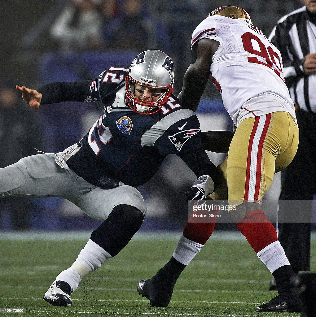 Patriots quarterback Tom Brady is tossed to the ground by 49ers linebacker Aldon Smith, as he is rushed into an incomplete pass. The New England Patriots hosted the San Francisco 49ers in a Sunday night NFL game at Gillette Stadium.