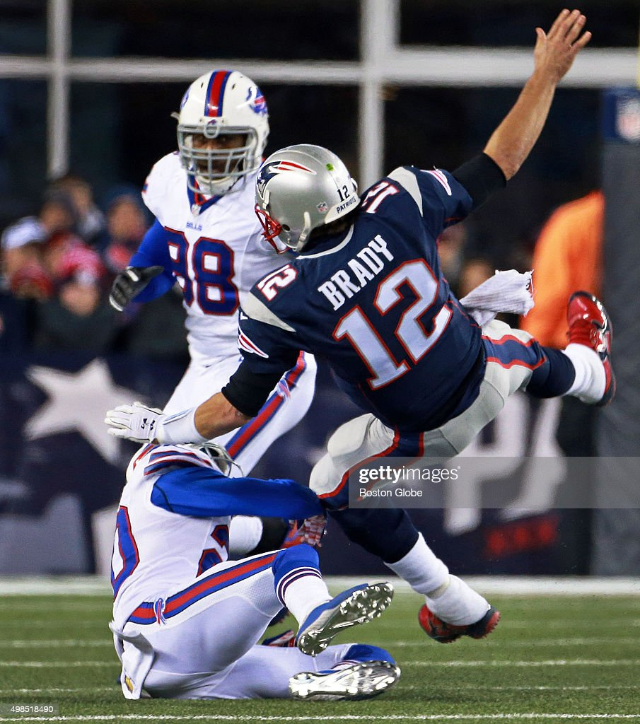 Patriots quarterback <a gi-track='captionPersonalityLinkClicked' href=/galleries/search?phrase=Tom+Brady+-+American+Football+Quarterback&family=editorial&specificpeople=201737 ng-click='$event.stopPropagation()'>Tom Brady</a> is upended by the Bills' Corey Graham after getting off a second quarter pass. The New England Patriots hosted the Buffalo Bills in a regular season Monday Night Football game at Gillette Stadium, Nov. 23, 2015.