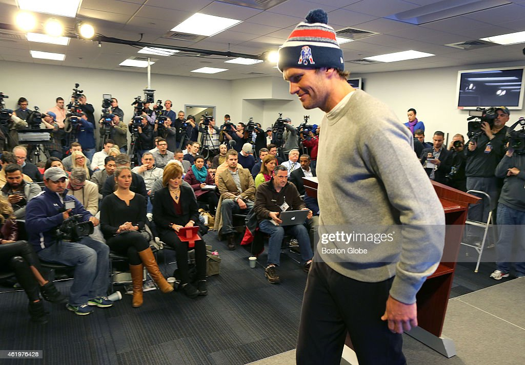 Patriots quarterback <a gi-track='captionPersonalityLinkClicked' href=/galleries/search?phrase=Tom+Brady+-+American+football-quarterback&family=editorial&specificpeople=201737 ng-click='$event.stopPropagation()'>Tom Brady</a> leaves the podium after speaking to the media at a press conference at Gillette Stadium about the under-inflated footballs used in the AFC Championship Game.