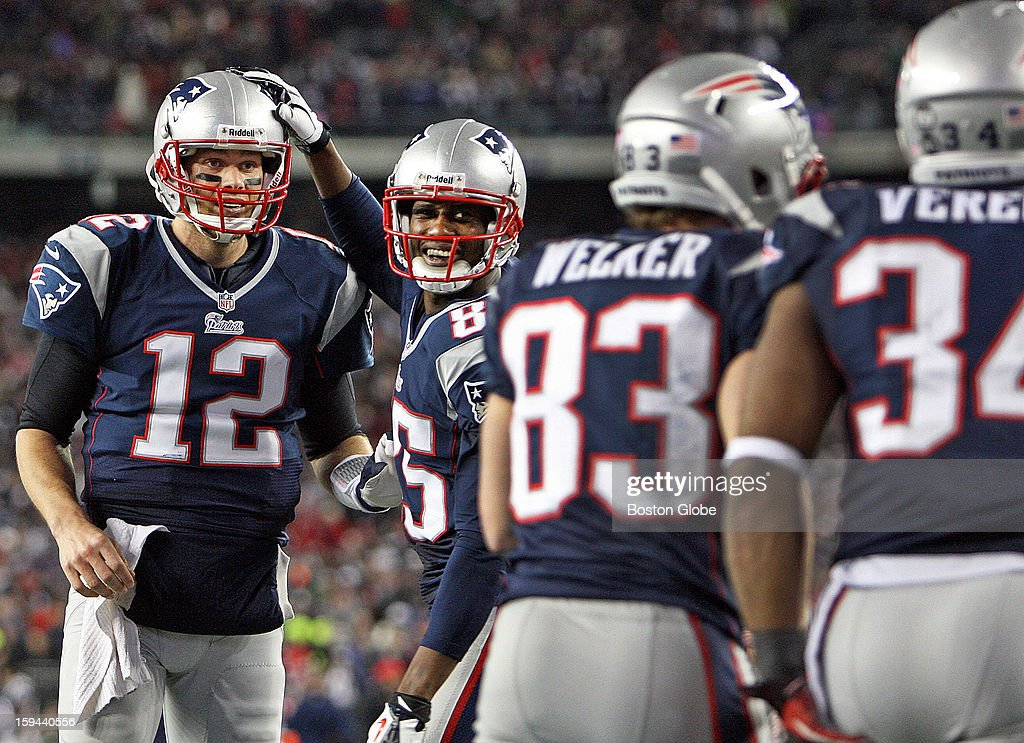 Patriots quarterback Tom Brady, left, and wide receiver Brandon Lloyd celebrate after running back Shane Vereen, far right, scored a touchdown on a 33-yard pass from Brady that helped seal the New England victory. It was Vereen's third touchdown of the game. The New England Patriots hosted the Houston Texans in an NFL Divisional Playoff Game at Gillette Stadium.
