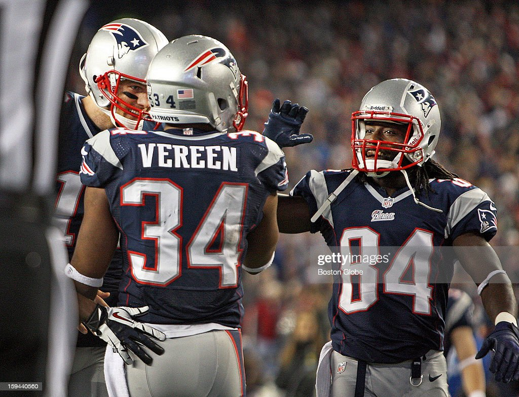 Patriots quarterback Tom Brady, left, and wide receiver Deion Branch, right, celebrate with running back Shane Vereen after he scored a touchdown on a 33-yard pass from Brady that helped seal the New England victory. It was Vereen's third touchdown of the game. The New England Patriots hosted the Houston Texans in an NFL AFC Divisional Playoff Game at Gillette Stadium, Jan. 13, 2013.