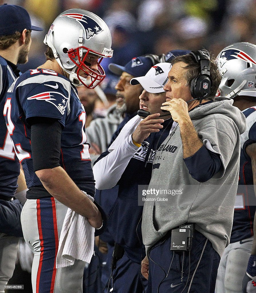 Patriots quarterback Tom Brady, left, listens to head coach Bill Belichick, right, as they converse on the sidelines during a timeout as the New England Patriots hosted the Houston Texans in an NFL AFC Divisional Playoff Game at Gillette Stadium, Jan. 13, 2013.