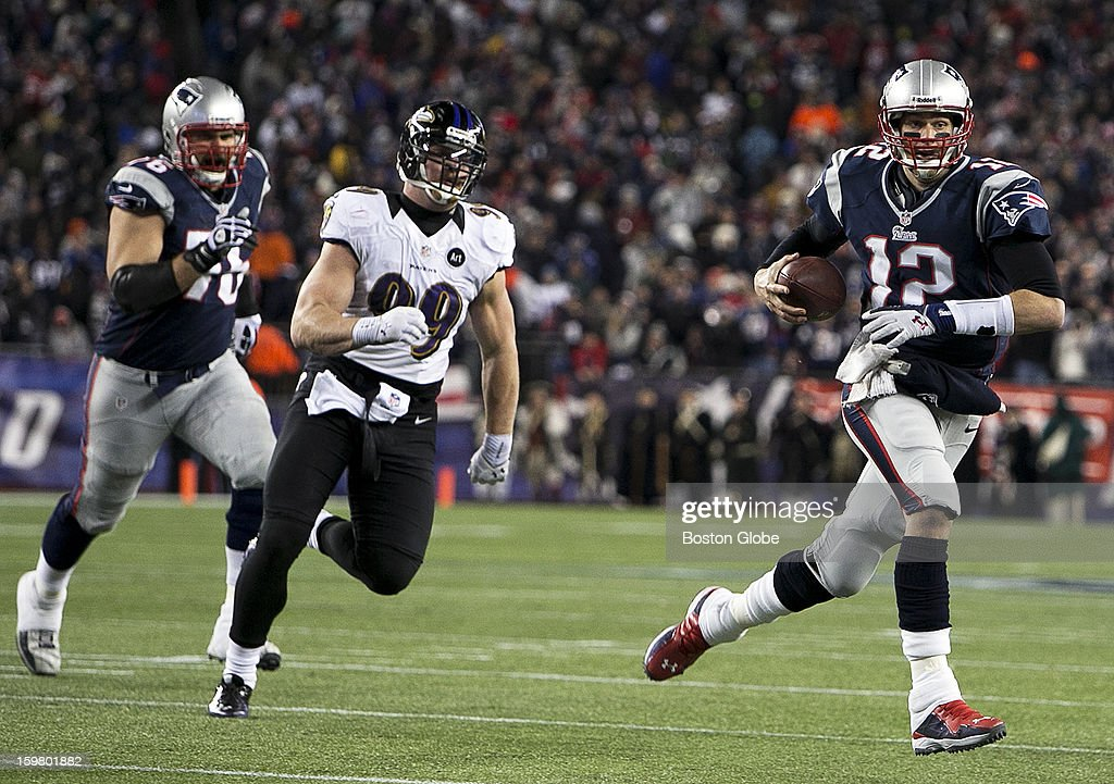 Patriots quarterback Tom Brady scrambles to get away from the Ravens Paul Kruger (#99) as the New England Patriots hosted the Baltimore Ravens in the AFC Championship Game at Gillette Stadium.