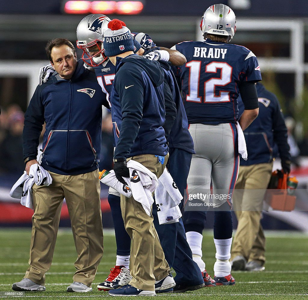 Patriots quarterback <a gi-track='captionPersonalityLinkClicked' href=/galleries/search?phrase=Tom+Brady+-+American+Football+Quarterback&family=editorial&specificpeople=201737 ng-click='$event.stopPropagation()'>Tom Brady</a> (#12) turns away as yet another of his receivers is helped off the field after being injured. This time it was wide receiver Aaron Dobson, who left after a second quarter catch. The New England Patriots hosted the Buffalo Bills in a regular season Monday Night Football game at Gillette Stadium, Nov. 23, 2015.