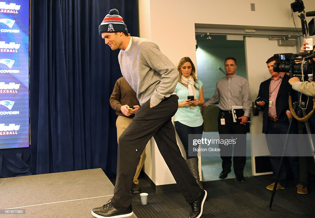 Patriots quarterback <a gi-track='captionPersonalityLinkClicked' href=/galleries/search?phrase=Tom+Brady+-+American+football-quarterback&family=editorial&specificpeople=201737 ng-click='$event.stopPropagation()'>Tom Brady</a> walks to the podium to speak to the media at a press conference at Gillette Stadium about the under-inflated footballs used in the AFC Championship Game.