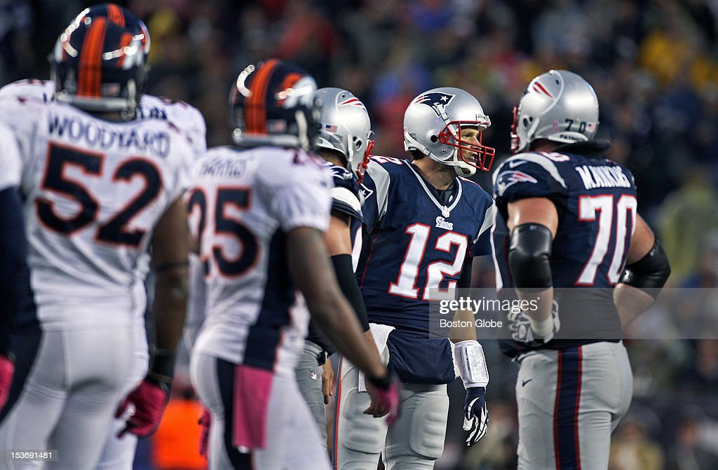 Patriots quarterback Tom Brady (#12) was barking out signals at the line of scrimmage on Sunday, as New England spent most of the game running their no huddle offense. The New England Patriots hosted the Denver Broncos in an NFL regular season game at Gillette Stadium.