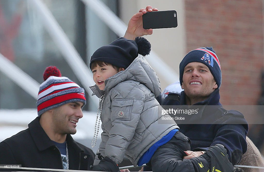 Patriots quarterbacks <a gi-track='captionPersonalityLinkClicked' href=/galleries/search?phrase=Jimmy+Garoppolo&family=editorial&specificpeople=12185713 ng-click='$event.stopPropagation()'>Jimmy Garoppolo</a>, left, and <a gi-track='captionPersonalityLinkClicked' href=/galleries/search?phrase=Tom+Brady+-+American+Football+Quarterback&family=editorial&specificpeople=201737 ng-click='$event.stopPropagation()'>Tom Brady</a>, right, enjoy the Patriots Super Bowl victory parade with Brady's son, Benjamin, from atop a duck boat.