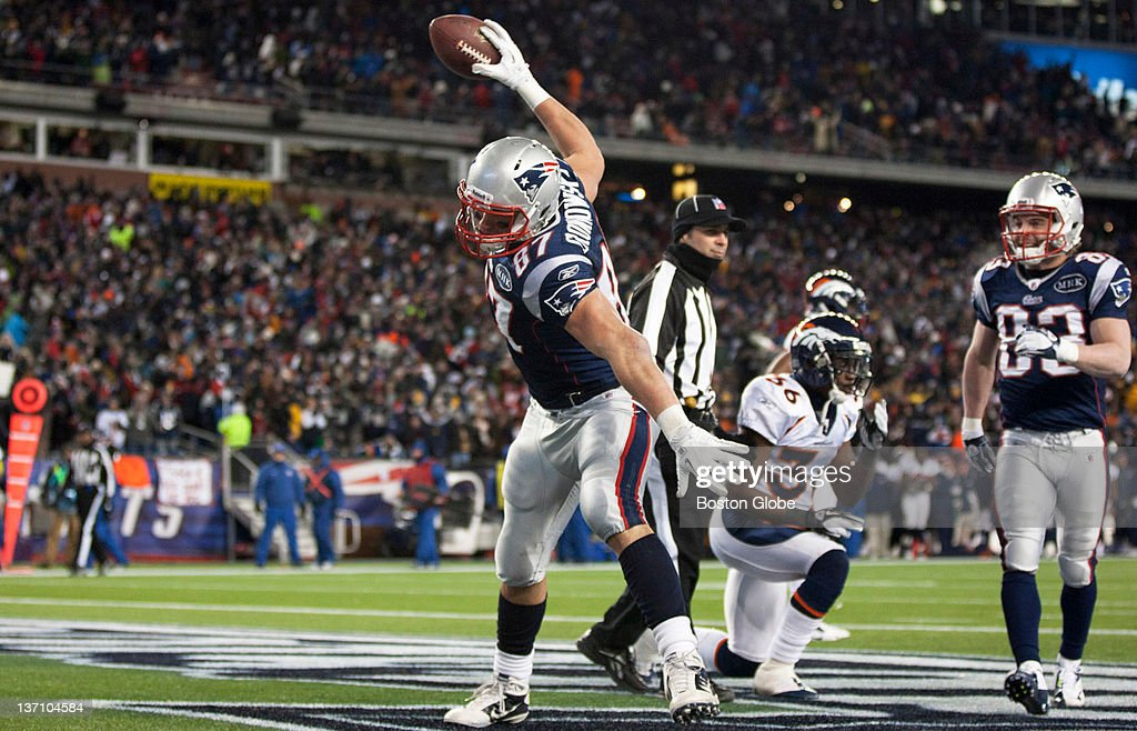 Patriots TE Rob Gronkowski spikes the ball after scoring his 3rd touchdown in the closing seconds of the first half in the 2nd quarter The New...