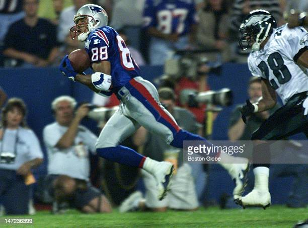 Patriots Terry Glenn catches a 45yard pass from Scott Zolak during 2nd quarter action against the Eagles