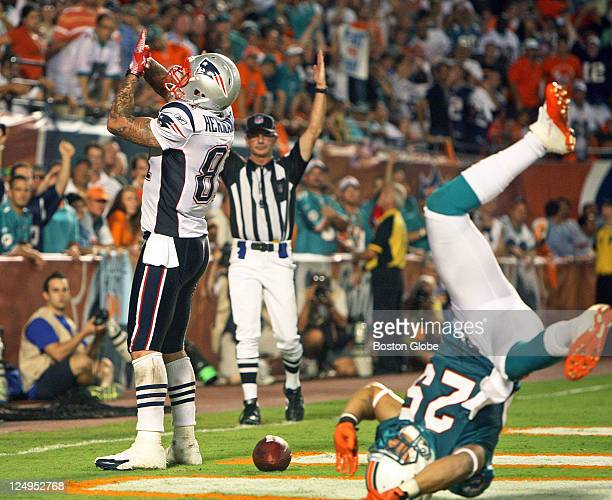 Patriots tight end Aaron Hernandez leaves Dolphins defender Jimmy Wilson upside down after he caught a touchdown pass from Tom Brady The New England...