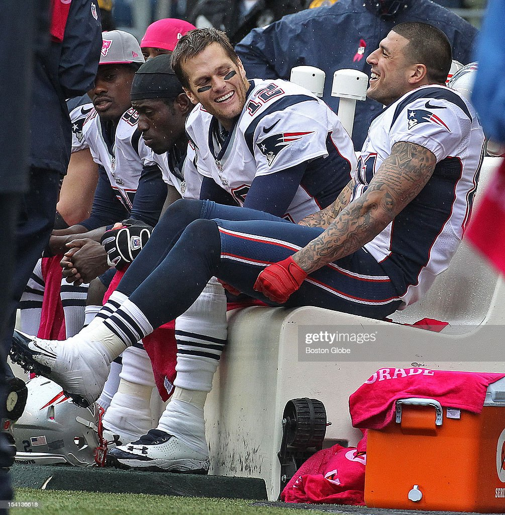 Patriots tight end Aaron Hernandez, right, was back in the New England lineup, and he and quarterback Tom Brady, left, were having some fun together on the bench after they hooked up on a one yard touchdown pass in the second quarter that put New England ahead 14-10. The New England Patriots visited the Seattle Seahawks in an NFL regular season game at CenturyLink Field.