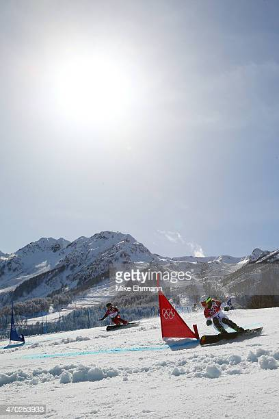 Patrizia Kummer of Switzerland and Ester Ledecka of the Czech Republic compete in the Snowboard Ladies' Parallel Giant Slalom Quarterfinals on day...