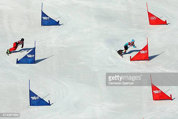Patrizia Kummer of Switzerland and Selina Joerg of Germany compete in the Snowboard Ladies' Parallel Slalom Qualification on day 15 of the 2014...