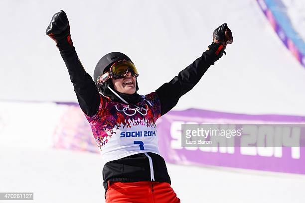 Patrizia Kummer of Switzerland celebrates winning the gold medal in the Snowboard Ladies' Parallel Giant Slalom Finals on day twelve of the 2014...