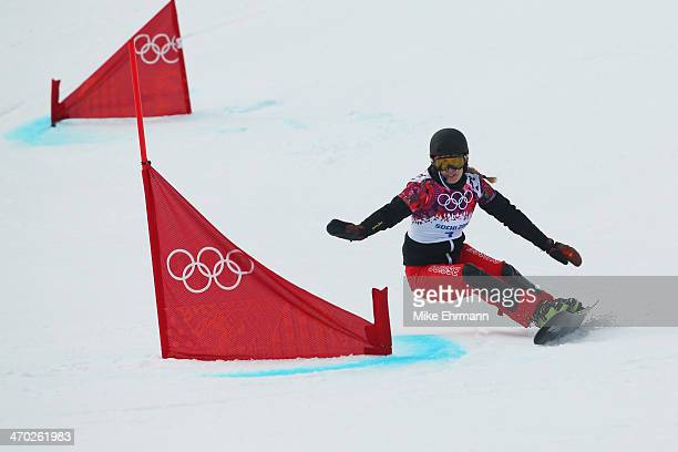 Patrizia Kummer of Switzerland competes in the Snowboard Ladies' Parallel Giant Slalom 1/8 Finals on day twelve of the 2014 Winter Olympics at Rosa...