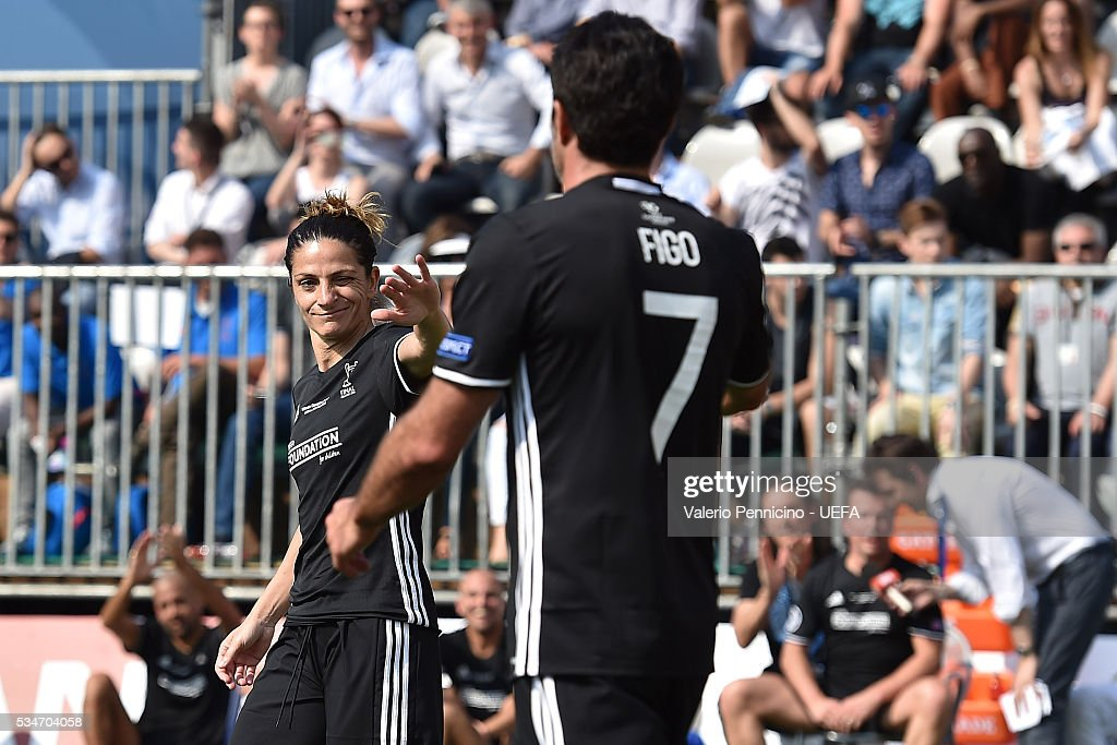 Patrizia Panico (L) of AC Milan & Inter Legends celebrates a goal with his team mate Luis Figo during the Ultimate Champions Match between Milan & Inter Legends and World All-Stars during the Champions Festival prior to the final at Stadio Giuseppe Meazza on May 27, 2016 in Milan, Italy.