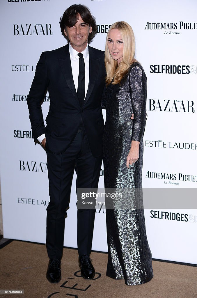 Patrizio di Marco and Frida Giannini attend the Harpers Bazaar Women of the Year Awards at Claridge's Hotel on November 5, 2013 in London, England.