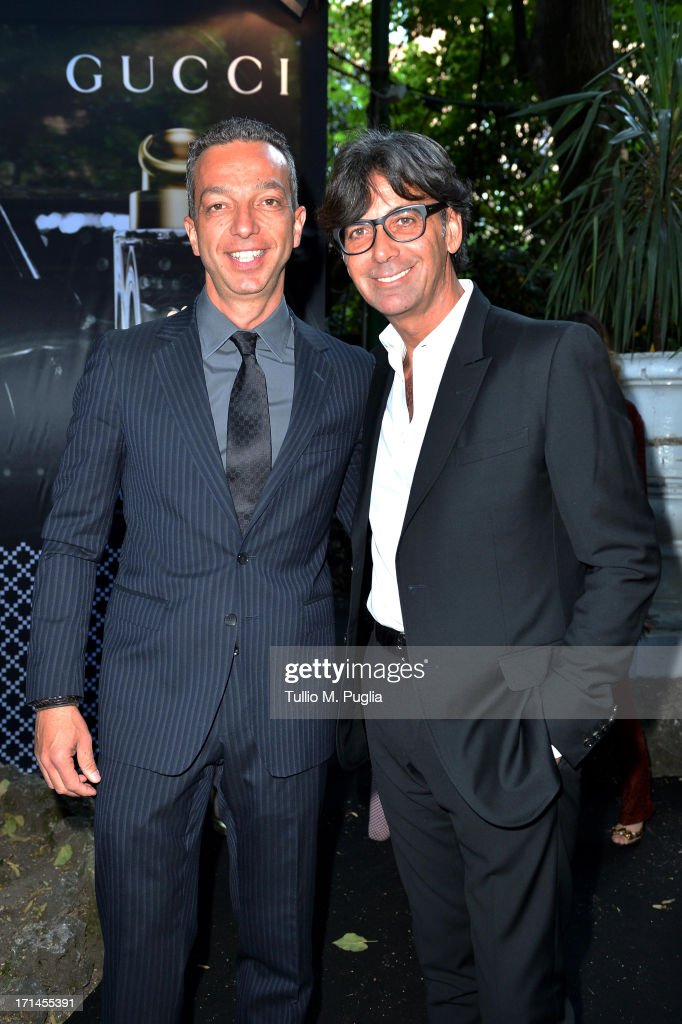 Patrizio di Marco (R) and Luigi Feola attend 'Gucci Made to Measure Launch' on June 24, 2013 in Milan, Italy.