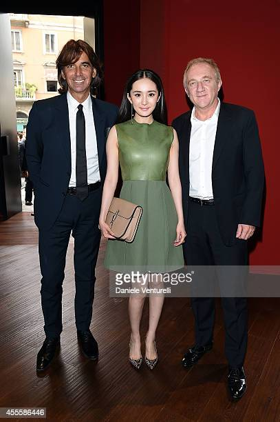 Patrizio Di Marco Yang Mi and FrancoisHenri Pinault attend the Gucci show as part of Milan Fashion Week Womenswear Spring/Summer 2015 on September 17...