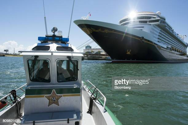 A patrol boat passes in front of the Disney Dream cruise ship docked at Port Canaveral in Cape Canaveral Florida US on Wednesday July 5 2017 The US...