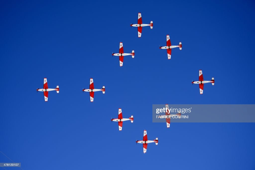 PC7 patrol planes of the Swiss Air Force fly in formation on March 12, 2014 during the Alpine ski World Cup finals in Lenzerheide. AFP PHOTO / FABRICE COFFRINI