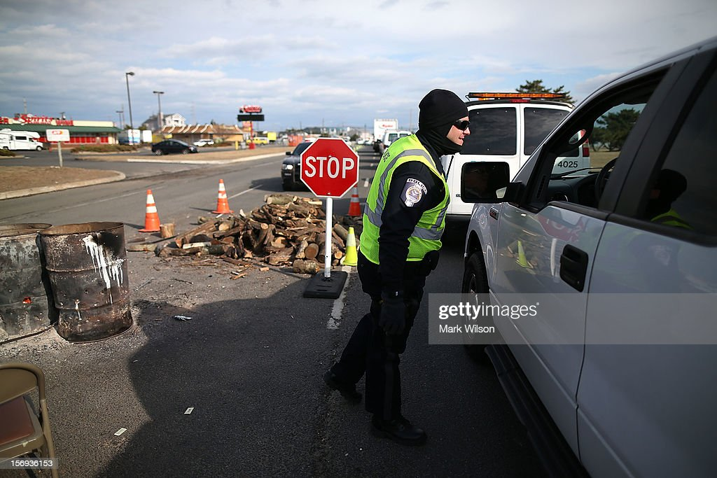Patrolman Ryan Greenhalgh works at a check point making sure only residents and contractors enter on November 25, 2012 in Ortley Beach, New Jersey. New Jersey Gov. Christie estimated that Superstorm Sandy cost New Jersey $29.4 billion in damage and economic losses.