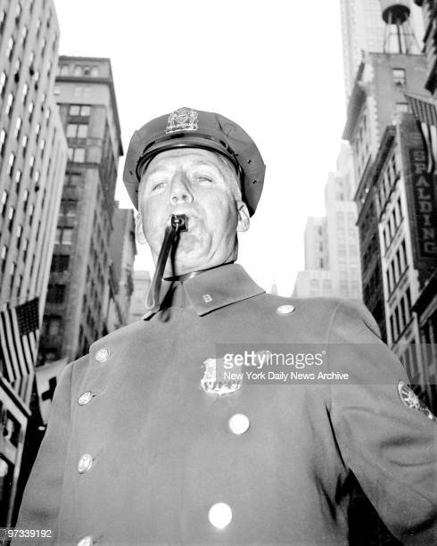 Patrolman Thomas Bell's whistle signals in the beginning of St Patrick's Day Parade from 44th St