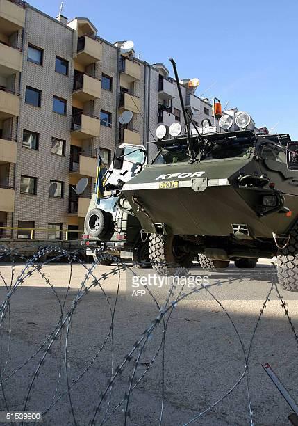 APC patrols the Serbian area of Pristina Kosovo 22 October 2004 14 million Kosovars will go on the polls Saturday 23 October to elect 120 members of...
