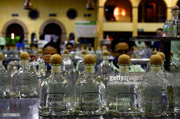 'Patron Distillery' employees put labels and check bottles of tequila during the process of production in Atotonilco Jalisco State Mexico on December...