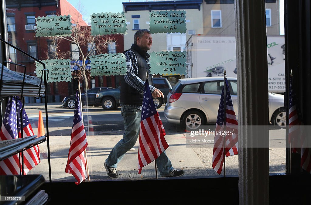 A patron enters a bagel shop in the Red Hook neighborhood of Brooklyn on December 5, 2012 in New York City. More than a month after superstorm Sandy flooded the area, some businesses have re-opened while many others remain closed pending repairs.