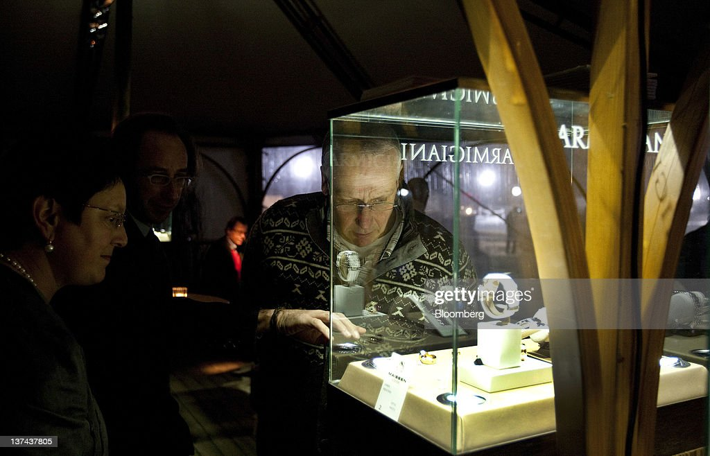 A patron looks at a Parmigiani watch display in the VIP tent at the annual Klosters Snow Polo event in Klosters, Switzerland, on Friday, Jan. 20, 2012. German Chancellor Angela Merkel will open next week's World Economic Forum in Davos, Switzerland, which will be attended by policy makers and business leaders including U.S. Treasury Secretary Timothy F. Geithner. Photographer: Scott Eells/Bloomberg via Getty Images
