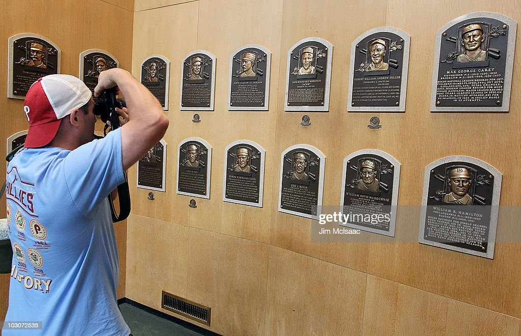 A patron of the Baseball Hall of Fame and Museum takes a photograph of the plaques of inducted members during induction weekend on July 24, 2010 in Cooperstown, New York.