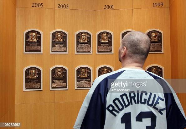 A patron of the Baseball Hall of Fame and Museum views the plaques of inducted members during induction weekend on July 24 2010 in Cooperstown New...