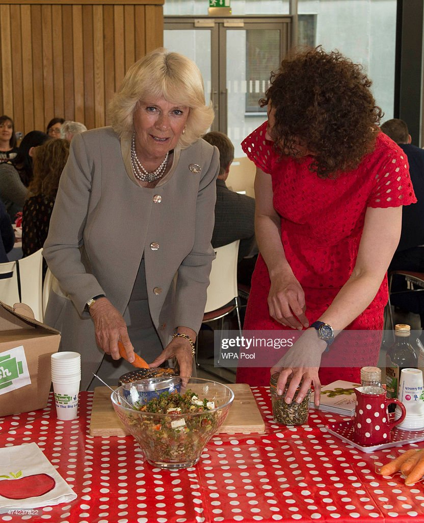 Patron of The Big Lunch Camilla, Duchess of Cornwall helps to make food as she attends a reception for supporters of the community initiative on May 21, 2015 in Belfast, Northern Ireland. Prince Charles, Prince of Wales and Camilla, Duchess of Cornwall will attend a series of engagements in Northern Ireland following their two day visit in the Republic of Ireland.