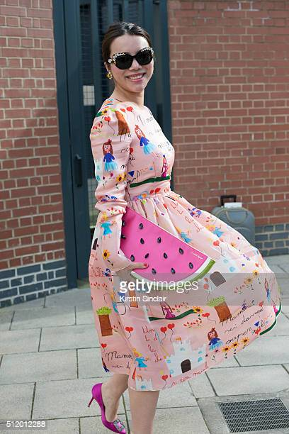 Patron of the British Fashion Council Wendy Wu wears Dolce and Gabbana dress and sunglasses Manolo Blahnik shoes and Charlotte Olympia bag on day 5...