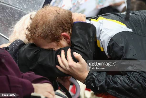 Patron of the Invictus Games Foundation Prince Harry hugs 97 year old Daphne Dunne during a walkabout in the torrential rain ahead of a Sydney 2018...