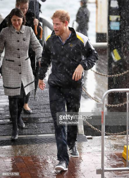 Patron of the Invictus Games Foundation Prince Harry meets members of the public during a walkabout in the torrential rain ahead of a Sydney 2018...