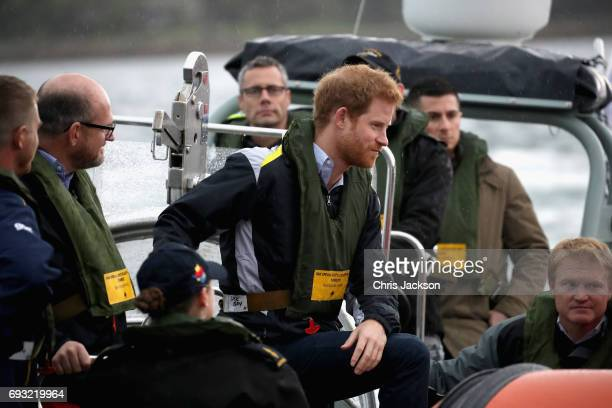 Patron of the Invictus Games Foundation Prince Harry watches an Invictus Games Sydney 2018 Sailing Event in Sydney Harbour on June 7 2017 in Sydney...