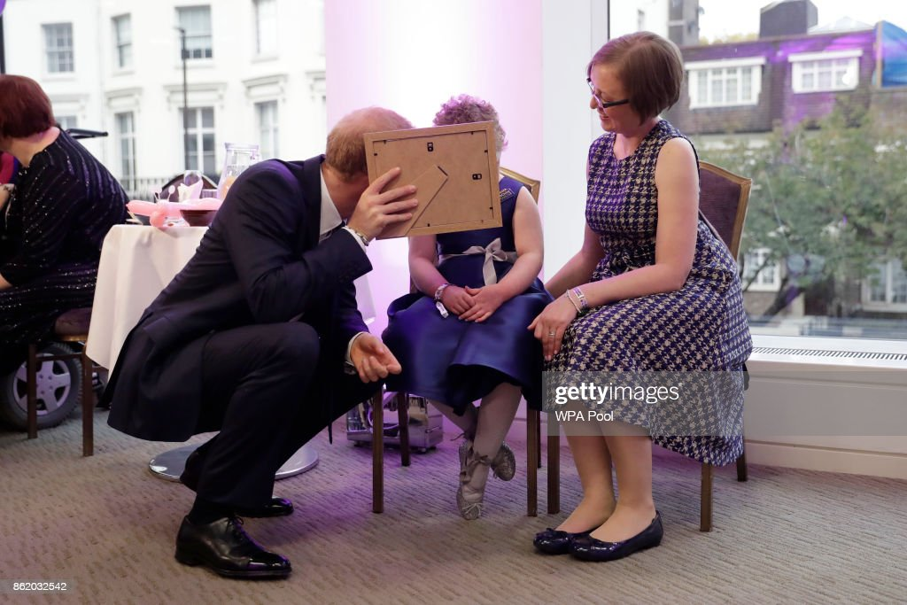 patron-of-wellchild-prince-harry-meets-erin-cross-aged-7-the-winner-picture-id862032542