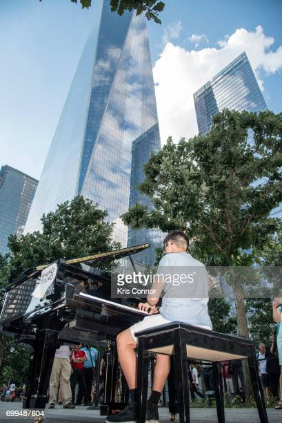 A patron performs the 'WTC @ WTC The WellTempered Clavier' as part of Make Music Day New York at the World Trade Center on June 21 2017 in New York...