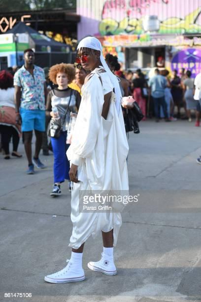 Patron pose for a photo at 2017 AfroPunk Festival Atlanta at Mechanicsville on October 14 2017 in Atlanta Georgia