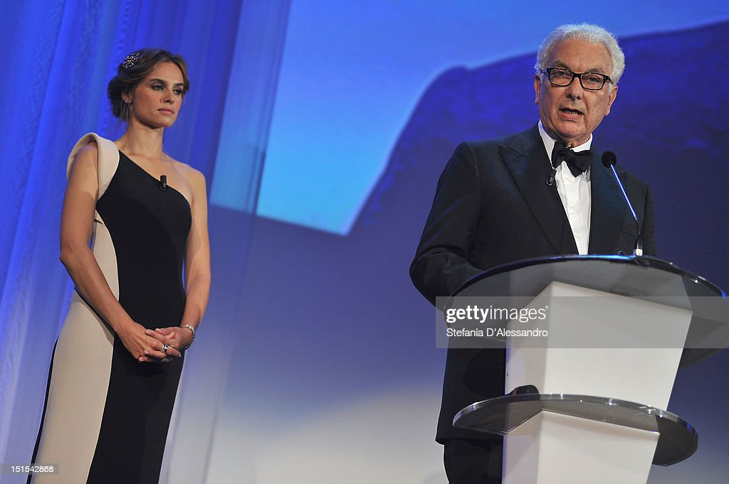 Patroness Kasia Smutniak watches as president of la Biennale di Venezia Paolo Baratta speaks during the Award Ceremony Inside during The 69th Venice...