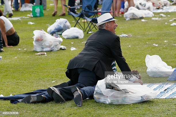 Patrons are seen having fun following 2015 Melbourne Cup Day at Flemington Racecourse on November 3 2015 in Melbourne Australia