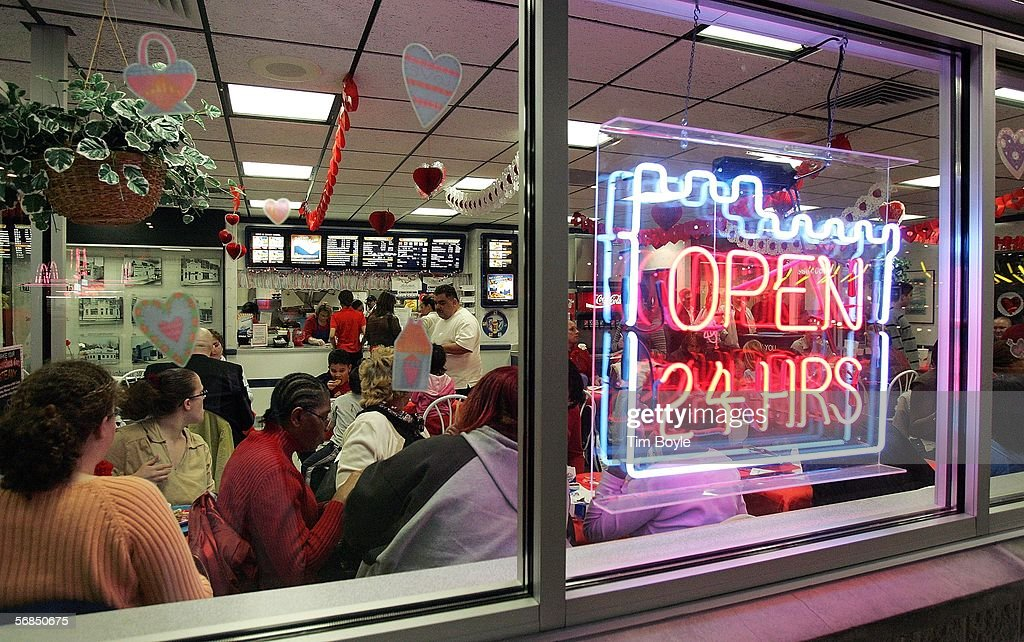 Patrons are seen inside a White Castle restaurant during a Valentine's Day dinner February 14, 2006 in Des Plaines, Illinois. For Valentine's Day, numerous White Castle restaurants nationwide took dinner reservations offering candlelit dining with individual servers as well as hostess seating.